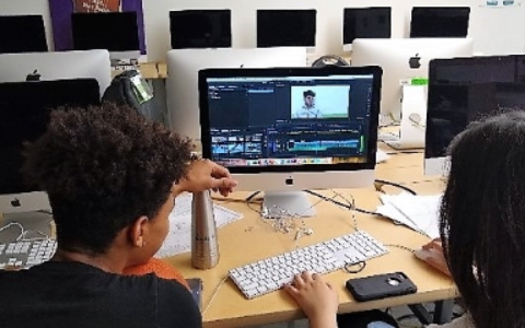 2 students sitting at a computer and editing a video in media arts class at Nova high school